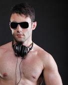Handsome man listening to music on headphone — Stock Photo