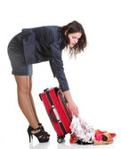 Full length young business woman to late red travel bagd — Stock Photo