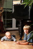 Little boy playing with a brother — Stock Photo