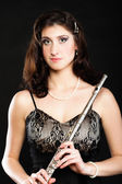 Art. Woman flutist flaustist musician with flute — Stock Photo