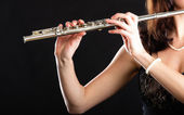 Art. Hands of flutist flaustist musician playing flute — Stock Photo