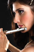 Art. Woman flutist flaustist musician playing flute — Stock Photo