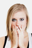 Surprised afraid girl covering mouth with hand — Stock Photo