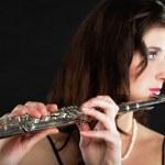 Art. Woman flutist flautist playing flute. Music. — Stock Photo #48784507