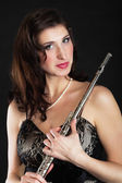 Art. Woman flutist flautist with flute. Music. — Stock Photo