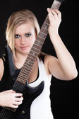 Rock music. Girl musician playing on electric guitar — Stock Photo