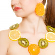Diet. Girl with necklace of fresh citrus fruits isolated — Stock Photo