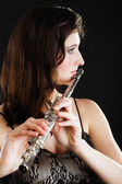 Art. Woman flutist flautist playing flute. Music. — Stock Photo