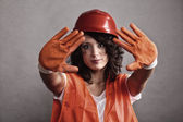 Sexy girl in safety helmet showing stop sign — Stock Photo