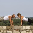 Pushups on a stone wall — Stock Photo #12695439