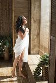 Girl standing near a window — Stock Photo