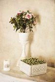 Flower arrangements on the shelf — Stock Photo