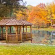 Stock Photo: Wooden gazebo on lake