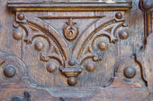 Part of the figure carved wooden doors — Stock Photo