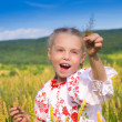 Happy girl on wheat field — Stock Photo
