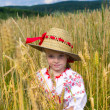 Stock Photo: Girl in a straw hat