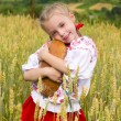 Stock Photo: Girl with bread