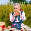 Girl with bread at field — Stock Photo #28607427