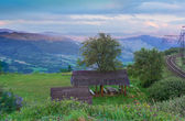 Landscape in the mountains with a gazebo — Stock Photo
