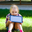 Girl with a tablet in hands — Stock Photo