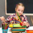 Portrait of schoolgirl with books and apple. School concept. — Stock Photo