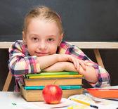 Portrait of schoolgirl with books and apple. School concept. — Stock Photo