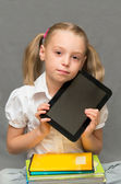 Schoolgirl with copybooks and tablet.School concept — Stock Photo