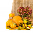 Harvested pumpkins with fall leaves, flowers and candle. — Stock Photo