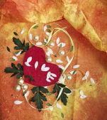 Coração vermelho com grânulos e fitas — Foto Stock