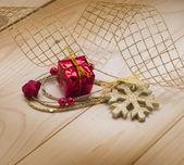 Christmas background with toys, golden ribbon, snowflake. — Stockfoto