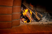 Fire burning in the fireplace — Stock Photo