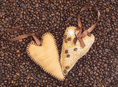 Hearts decorated with coffee beans with ribbons — Stock Photo