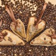 Stock Photo: Four decorated hearts with ribbons and coffee beans.