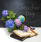 Teacher Day.Flowers hydrangeas and school subjects.  — Stock Photo