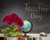 Red flower and a globe . Teacher  Day. — Stock Photo