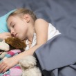 Child sleeping with her a favorite toy — Stock Photo