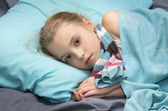 Sick girl lying in her bed — Stock Photo