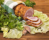 Baked boiled pork with greenery — Stock Photo