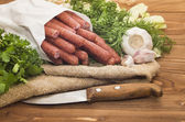Hunting sausages in a white package — Stock Photo