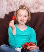 Little girl eating strawberries — Stock Photo