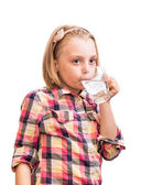 Cheerful child drinking mineral water. — Stock Photo