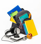Backpack with school supplies and a tablet with headphones.  — Stock Photo