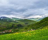 Mountain village near the mountains with fog — Stock Photo
