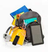 School backpack with school supplies and a tablet with headphon — Stock Photo