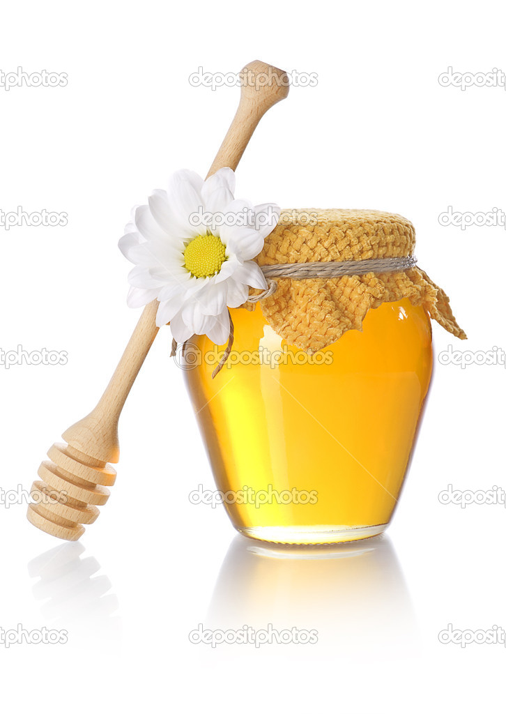 Honey jar with honey dipper on white background — Stock Photo #14061189