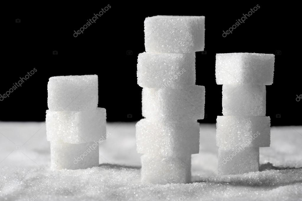 Pile of sugar cubes on black and white background — Stock Photo #14061194