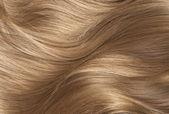 Long blond human shiny hair — Stock Photo
