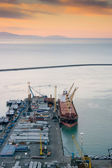 Harbor with ship and cargo — Stock Photo