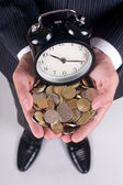 Coins and alarm — Stock Photo