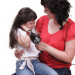 Stock Photo: Womand daughter Little girl dries hair isolated